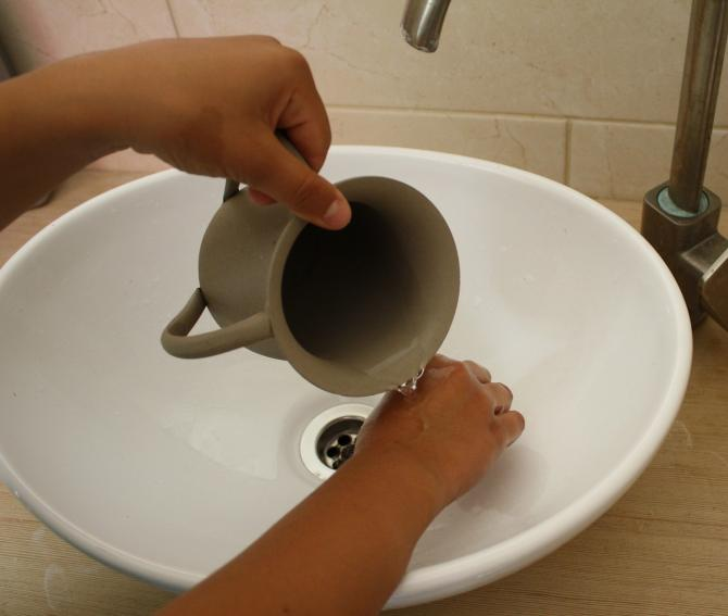 ritual handwashing with pitcher and basin