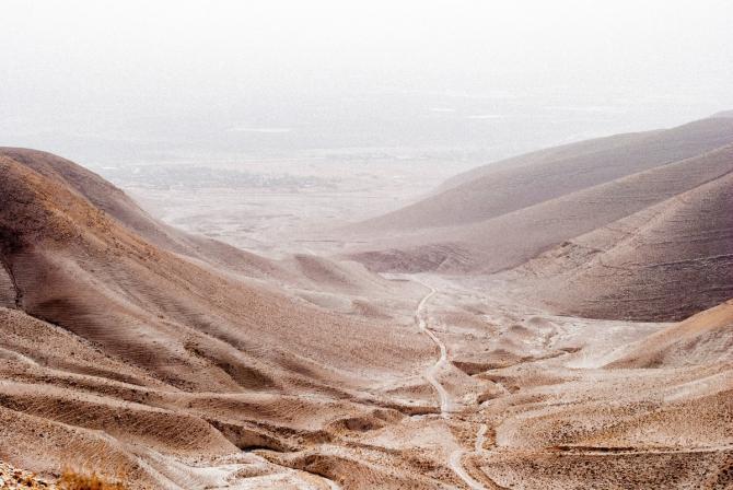 desert road in valley between mountains