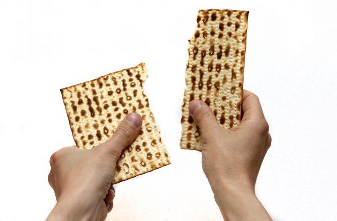 Matzah being broken in half