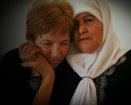 Two women comfort one another - one Israeli, one Palestinian